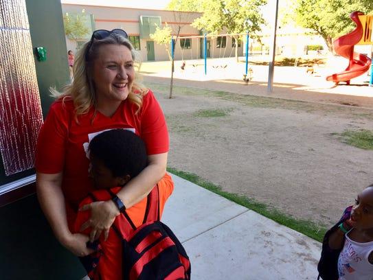 Kindergarten teacher Jennifer Zamenski greets her students: