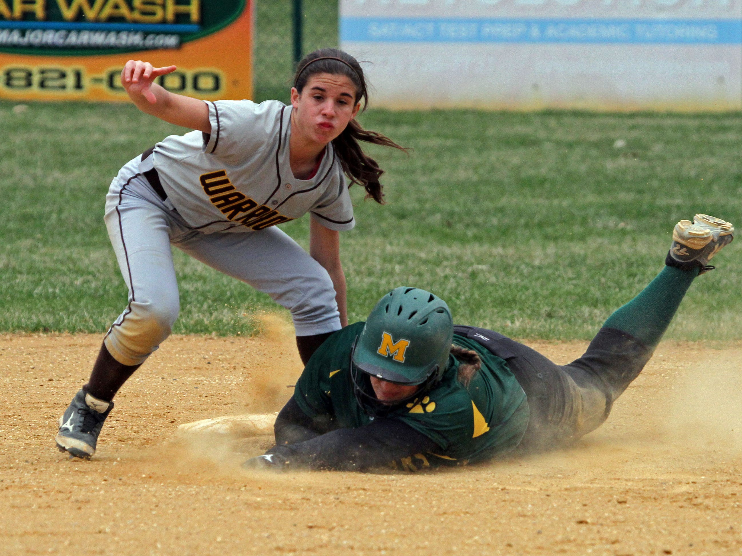 Montgomery's Gillian O'Connor is out by Watchung Hills' Tina Zoppi, as she tries to steal second base. This is action of Watchung Hills at Montgomery in girls softball.