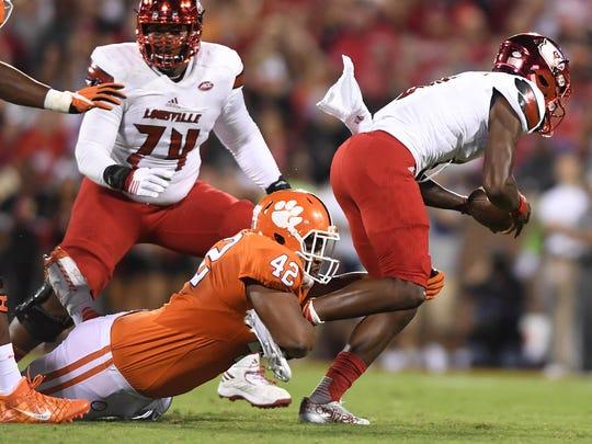 Clemson defensive lineman Christian Wilkins sacks Louisville quarterback Lamar Jackson.