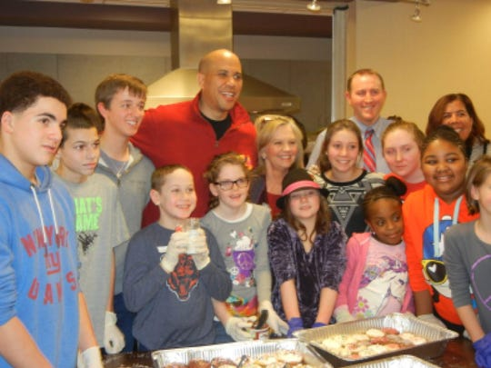 Senator Cory Booker and Assemblywoman Linda Stender joined Fanwood/Scotch Plains residents to make and deliver dinner to the needy at the Scotch Plains YMCA at last year's event.