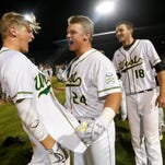 Iowa City West designated hitter Jason Strunk (24) celebrates with his teammates after hitting a walk off home run against Roosevelt Friday, July 29, 2016, during their class 4A semifinal game at the state baseball tournament at Principal Park in Des Moines