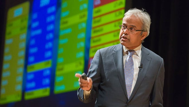 """Colorado State University College of Business Dean Ajay Menon speaks on the topic """"Imagining Innovation: Building innovative and smart communities,"""" during the President's Community Lecture, March 4, 2015."""