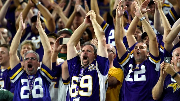 """Fans clap in unison during a """"Viking Chant"""" before"""