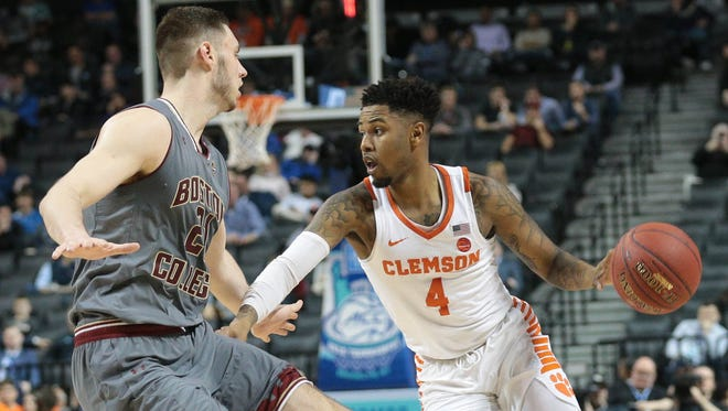 Clemson Tigers guard Shelton Mitchell (4) moves the ball against Boston College Eagles forward Nik Popovic (21) during the first half of a quarterfinals game of the 2018 ACC tournament at the Barclays Center In New York, N.Y.