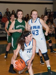 McConnellsburg's McKenzie Gelvin (11) grabs a rebound