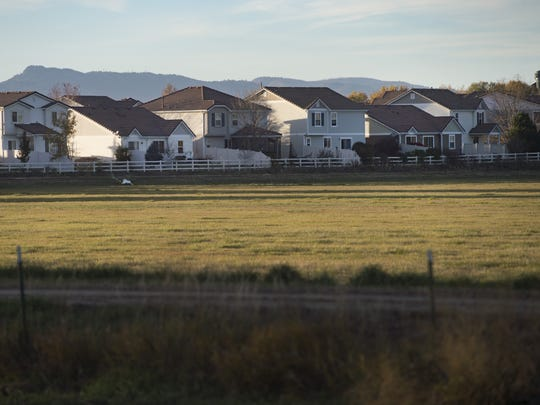 Light fades on the Thompson River Ranch neighborhood in Johnstown on Tuesday, October 24, 2017. An open field bordering homes is the site of a proposed gravel pit that residents believe will impact the value of their homes as well as quality of life.
