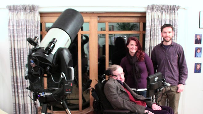Stephen Hawking, Michelle Meskill and Bryan Cogdell in Hawking's home.
