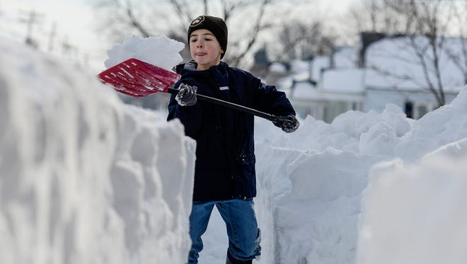 Cian Soliday, 8, shovels a path for the mailman at his grandparents house in Cleona Borough, Pa.