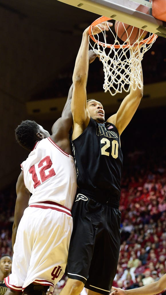 Purdue center A.J. Hammons (20) dunks against Indiana forward Hanner Mosquera-Perea during a 67-63 Boilermaker victory at Assembly Hall.