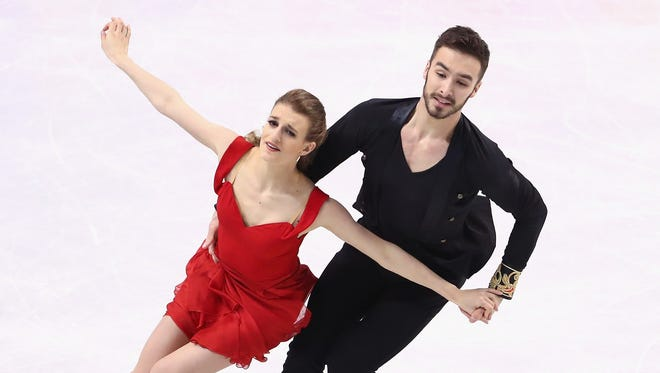 Gabriella Papadakis and Guillaume Cizeron of France skate in the Ice Dance Short program during day 3 of the ISU World Figure Skating Championships 2016 at TD Garden on March 30, 2016 in Boston, Massachusetts.