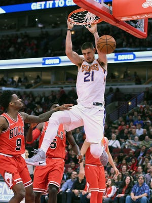 Nov 28, 2017: Phoenix Suns center Alex Len (21) dunks the ball against Chicago Bulls guard Antonio Blakeney (9) during the first half at the United Center.