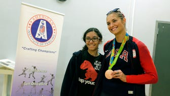 Monica Aksamit, a Matawan High School graduate who just won a bronze medal in fencing at the Olympics, poses with Roxanne Palladino, 14, of Marlboro during a fencing camp at St. John Vianney High School.