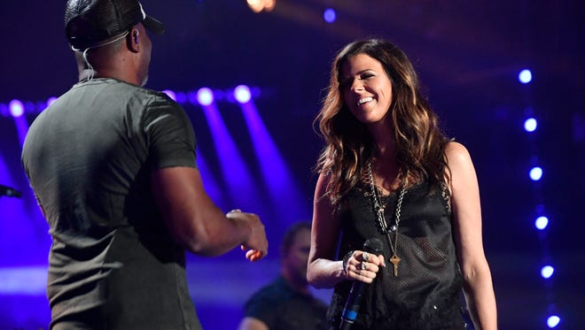 Darius Rucker performs with Karen Fairchild of Little Big Town at Nissan Stadium on the final day of CMA Fest 2017, on Sunday, June 11, 2017, in Nashville, Tenn.