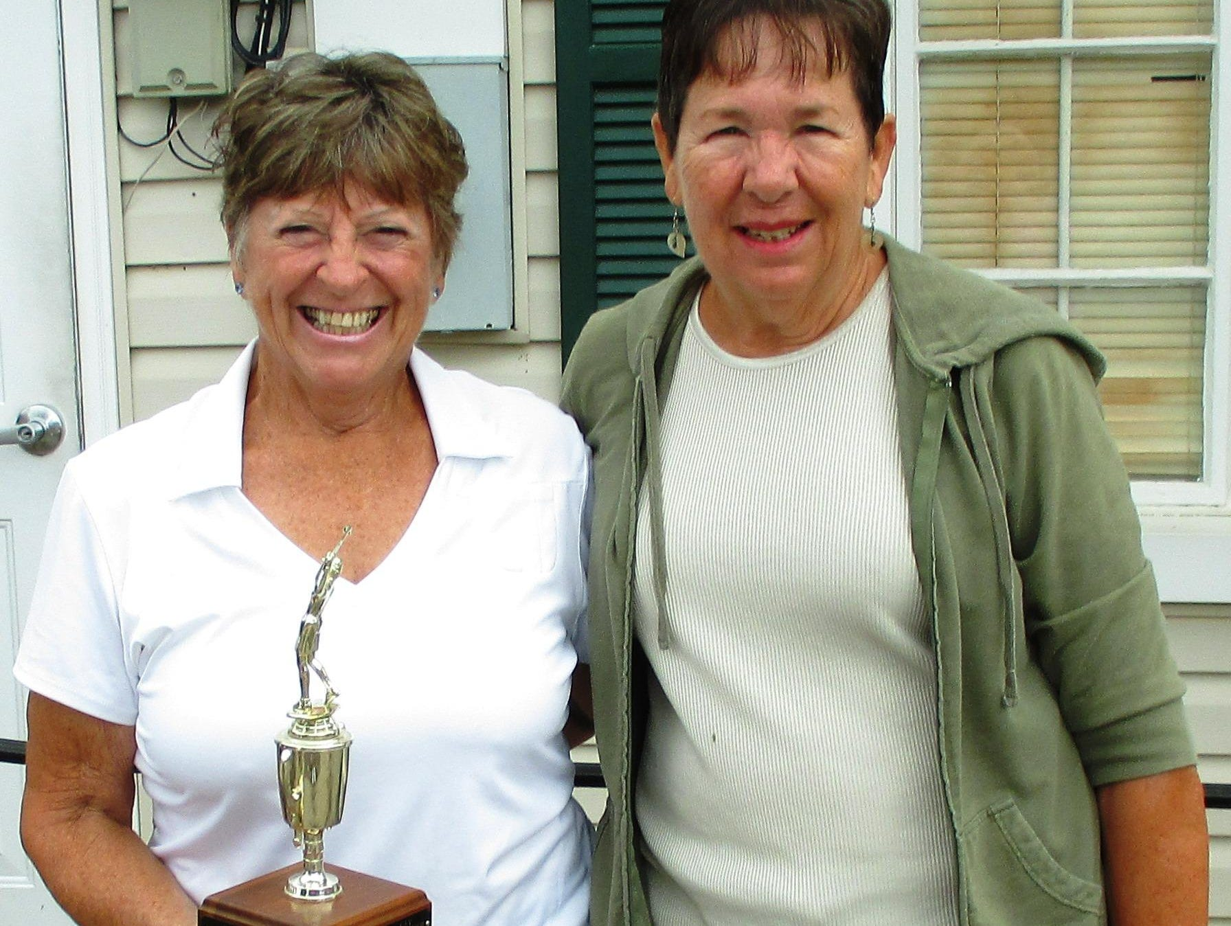 Bobbie Lent, left, holds the 2015 President's Cup after taking first place in the Twin Lakes Ladies Golf League match play event for 18-hole players, which ran through June. Gail Alter took second place. The ladies league has held the President's Cup tournament for more than 20 years.