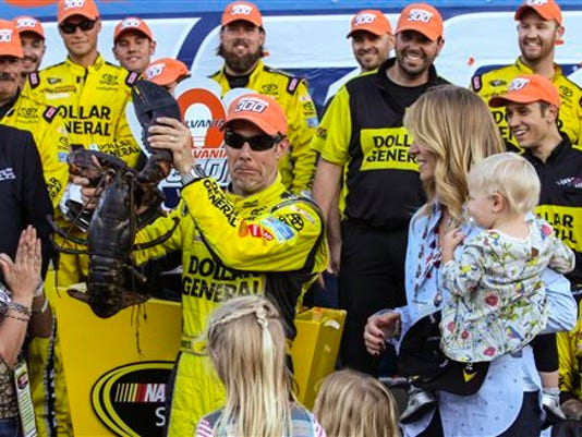 Matt Kenseth holds a lobster in Victory Lane after winning the NASCAR Sprint Cup series auto race at New Hampshire Motor Speedway in Loudon on Sunday.