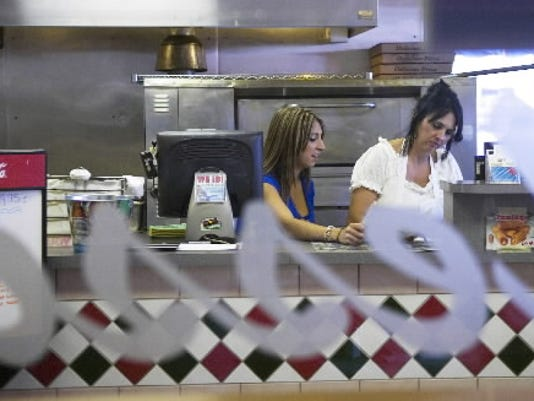 Co-owner Pat Ferrante, right, and her daughter, Adriana, work behind the counter at Messina Italian Restaurant.