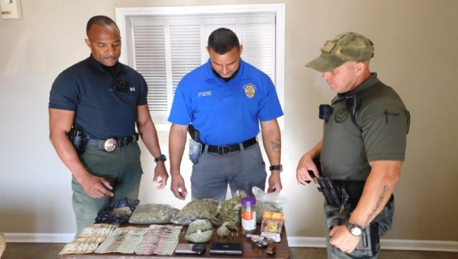 Police seized several pounds of synthetic marijuana and arrested three after an investigation at a home in Opelousas.
