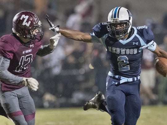 Redwood's Michael Harris III, right, fends off Mt.