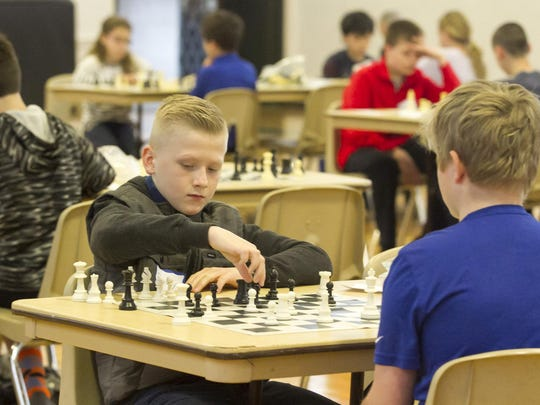 """Brody Levy, 10, of Hopatcong, makes a move during a match. The Knights of Columbus host their annual """"Chess 'Round-Robin' Tournament Anyone?"""" for grades 3-8, at Holy Family Roman Catholic Church, Florham Park, NJ. Sat., April 1, 2017. Special to NJ Press Media/Karen Mancinelli/Daily Record MOR 0402 K of C Chess Tournament"""