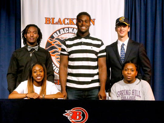 Blackman football players and girls soccer players sign letters of intent on national signing day Wednesday, Feb. 7, 2018, at Blackman. Football players (L to R ) back row James Carson will play football at Indiana Wesleyan University, Ben Kalu will be playing football at Lindsey Wilson College and Thomas Burks will be playing football at Chattanooga. Front Row (L to R) Alaysha Russelll will be playing soccer at Alabama A&M and Carrington McKenzie will be playing at Spring Hill College.