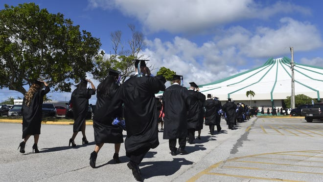 The University of Guam Fall 2015 Commencement Ceremonies were held at the UOG Calvo Field House in Mangilao.