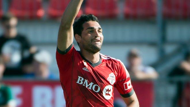 Gilberto celebrates his goal during Toronto FC's 3-0 win.