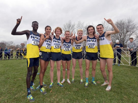 NAU runners pose after winning the team title during