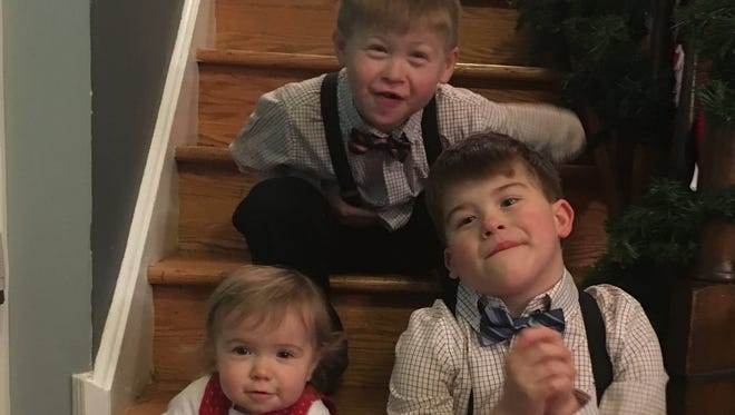 Eight-year-old Dylan Sexton (bottom right) and his 6-year-old brother, Logan, (top) have a genetic disorder called MED13L syndrome. When the Barrington boys were diagnosed two years ago, they were the only known siblings in the world to share the disorder. Their 2-year-old sister, Maggie (bottom left), shows no symptoms of the disorder and has not been tested. Their parents are working to raise awareness and research funding in observation of Rare Disease Day on Feb. 28.