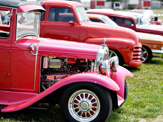 National Street Rod Association members arrive for