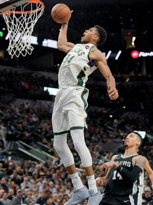 Giannis Antetokounmpo had 28 points, 12 rebounds, five assists and four blocks in a Bucks' victory over the Spurs on Friday night.
