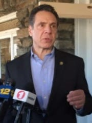 Gov. Andrew Cuomo speaks to reporters outside the VFW Hall in Larchmont, N.Y., on March 11, 2018.