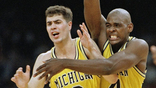 Michigan's Chris Webber and Rob Pelinka celebrate in New Orleans as they defeated Kentucky 81-78 to advance to the NCAA college basketball championship game against UNC. Pelinka, a longtime sports agent whose clients included Kobe Bryant, was formally named the Lakers' new general manager Tuesday, March 7, 2017.