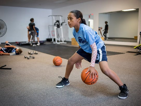 Phoenix Glassnor, 10, practices dribbling and ball