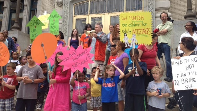 Yonkers parents and public school students rally at City Hall against budget cuts in June 2012.