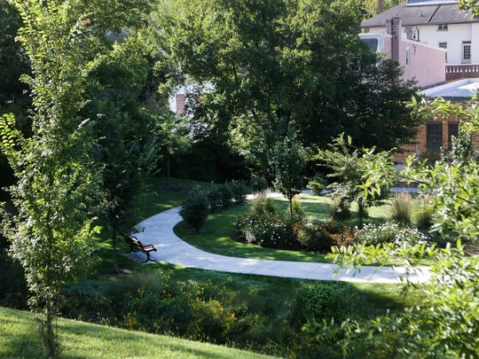 The St. Francis Court Apartments project at 1860 Queen City Avenue, within the Lick Run watershed, involves converting two unused parking lots into upper and lower bio-infiltration basins (also known as rain gardens). A walking path was also added as a community amenity.