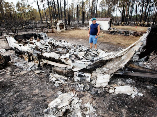 """""""We lost material things. But, thank God, we didn't lose life,"""" Eduardo Romero said of the damage to his brother's home in Lehigh Acres."""