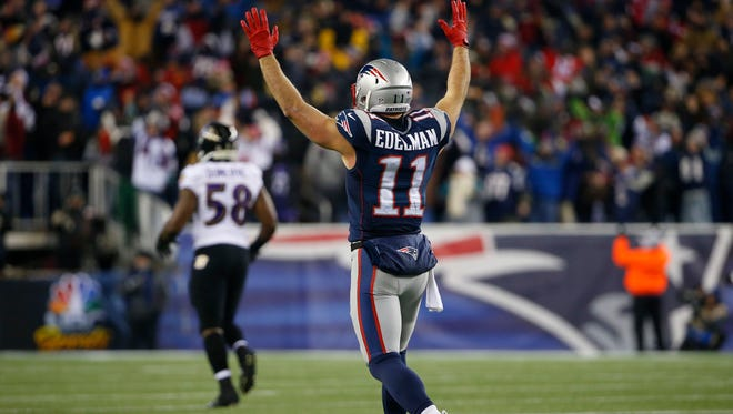 New England Patriots wide receiver Julian Edelman celebrates after throwing a touchdown pass during the third quarter against the Baltimore Ravens.