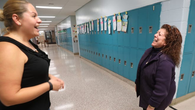 Haledon Public School teachers Christina Sanchez and Carol Molinari share a moment of laughter in the hallway after school. They were the recipients of Teacher Recognition Awards.