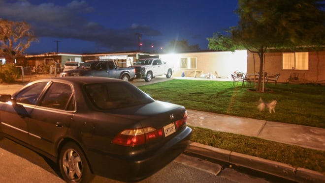 Car pack the drive way and street in front of a house in Coachella on Thursday, January 5, 2017.