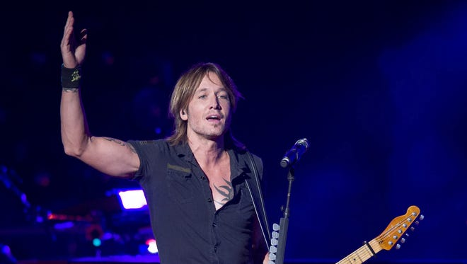 Keith Urban, pictured during a 2013 performance at Klipsch Music Center, will attend the Indianapolis 500 on May 29.