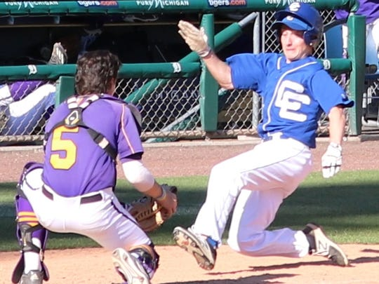 CC's Marcus Cipriano (right) slides into home plate
