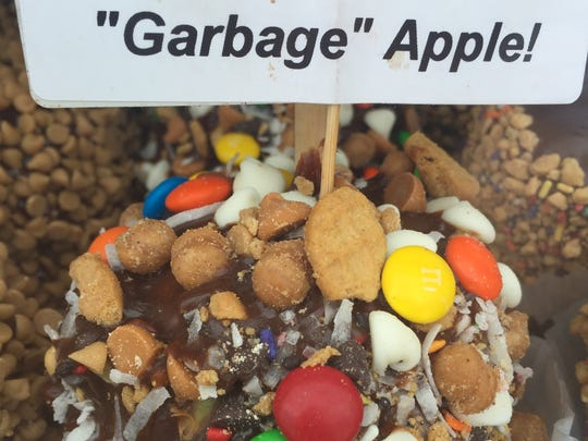 """The Rochester """"Garbage"""" Apple is a candy apple covered in a variety of treats. It can be found at this year's Lilac Festival."""