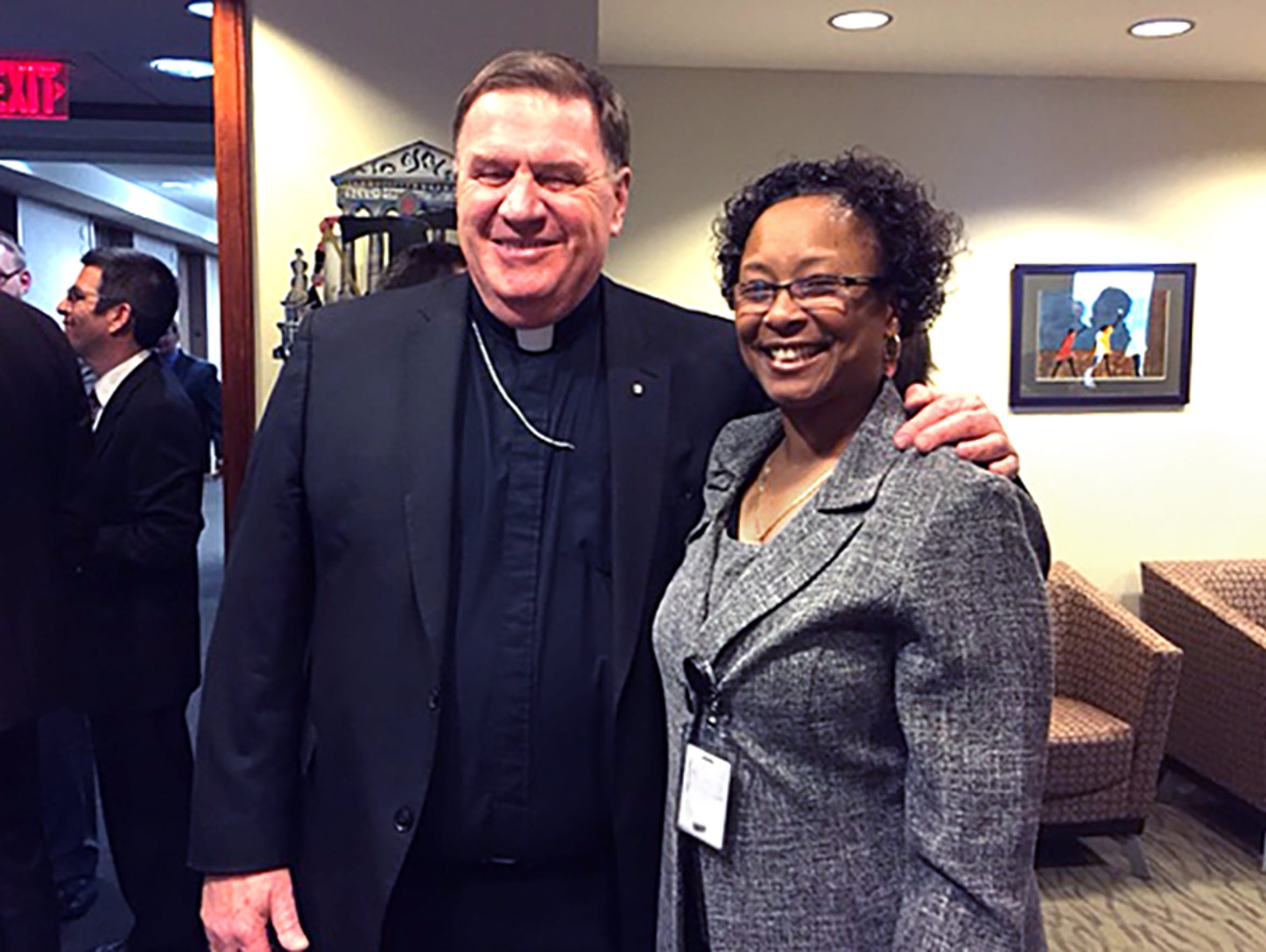 Paula Cooper (right) is shown March 5, 2015 with Archbishop