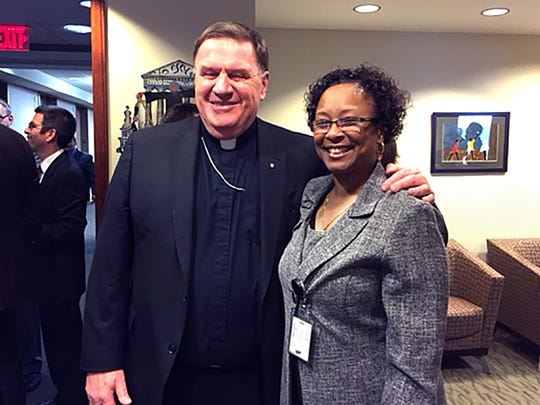 Paula Cooper (right) is shown March 5, 2015 with Archbishop Joseph Tobin of Indianapolis.