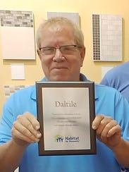 Brad Dixon of Daltile participates in the St. Lucie