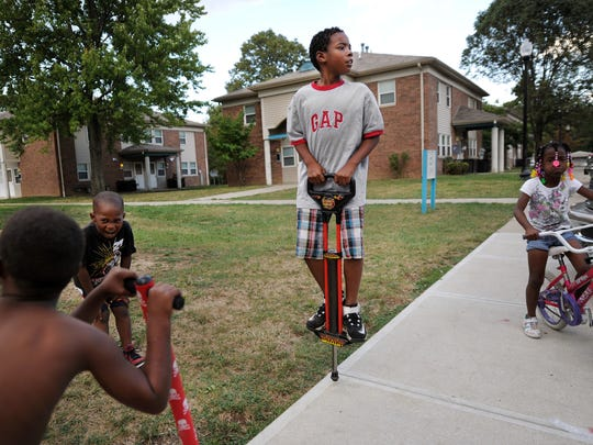 Damarcus Cole, 9 of Indianapolis, plays inside the Hawthorne Place Apartments off 32nd and Emerson with other kids from the complex on Thursday, September 13, 2013. Mom Tyeisha Tillman is looking to move out of the complex to provide a better environment for her five children as three people have been killed on the grounds since May.