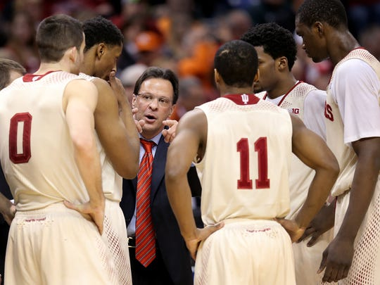 Indiana head coach Tom Crean talks to his players during a timeout in the second half of game during the Big Ten Men's Basketball Tournament, March 13, 2014, at Bankers Life Fieldhouse.