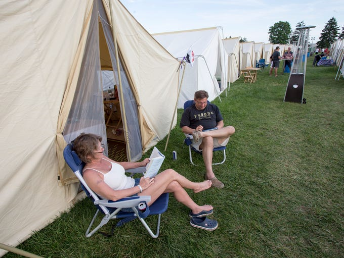 Marriette Siler and her husband Gene Siler, New Castle, sit in mild temperatures outside their glamping tent at the Indianapolis Motor Speedway, Thursday, May 23, 2014.