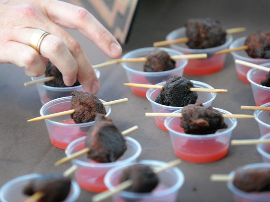 Severin Bar's Pulled Pork Fritter & Watermelon Gastrique Shooter during the 4th Dig IN, a celebration where local chefs, restaurants and brewers come together in White River State Park, 2013.