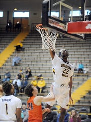 Southern Miss player Quinton Campbell shoots for the basket in a game against UTEP in Reed Green Coliseum on Saturday.